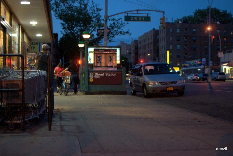 night scene of a Brooklyn sidewalk